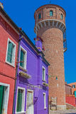 Colorful houses and water tower in Burano, Italy Stock Image