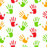 Colorful human hands imprints on white seamless pattern, vector. Background Royalty Free Stock Photo