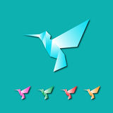 Colorful hummingbirds. On sky blue background Royalty Free Stock Image