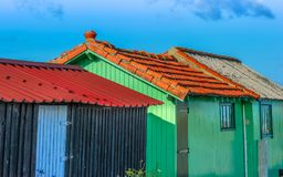 Colorful huts of fishermen against clear sky Stock Image