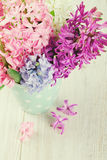 Colorful hyacinth flowers in a polka dot cup Royalty Free Stock Images