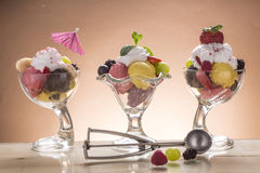 Colorful ice cream cup with fruits for the hot summer days Stock Image