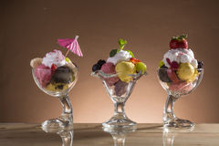 Colorful ice cream cup with fruits for the hot summer days Stock Photos
