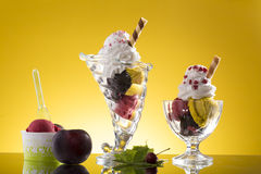 Colorful ice cream cup and plastic cup on yellow background Stock Photo