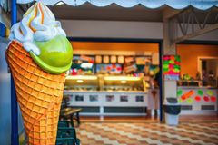 Colorful ice cream parlor vintage sign and shop Stock Image