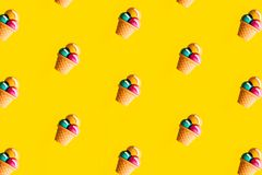 Colorful ice cream pattern on yellow background. Creative minimal summer royalty free stock photos