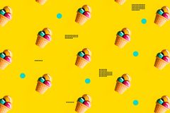 Colorful ice cream pattern on yellow background. Creative minimal summer stock photography