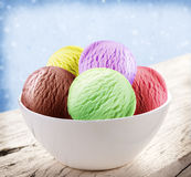 Colorful ice-cream scoops in white cones. Stock Images