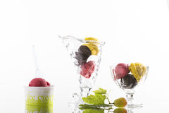 Colorful ice cream sundaes, and takeaway cup on white background Royalty Free Stock Photo