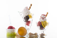 Colorful ice cream sundaes, and takeaway cup on white background Royalty Free Stock Photography
