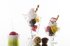 Colorful ice cream sundaes, and takeaway cup on white background Stock Images