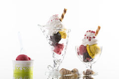 Colorful ice cream sundaes, and takeaway cup on white background Stock Photography