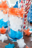 Colorful ice cubes. Red, white and blue ice cubes in star shapes Royalty Free Stock Photos