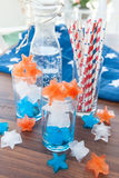 Colorful ice cubes. Red, white and blue ice cubes in star shapes Stock Photos