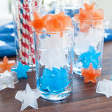 Colorful ice cubes. Red, white and blue ice cubes in star shapes Royalty Free Stock Image
