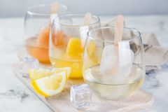 Colorful ice popsicles with wine in glasses Stock Image