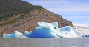 Colorful Iceberg by an Active Glacier Royalty Free Stock Images