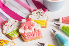 Colorful icing cookies in cupcake shape Stock Photography
