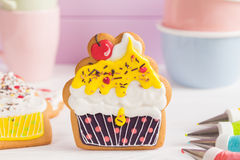 Colorful icing cookies in cupcake shape Royalty Free Stock Images