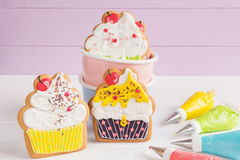 Colorful icing cookies in cupcake shape Royalty Free Stock Photos