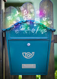 Colorful icons and symbols bursting out of a mailbox Stock Images