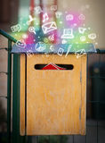 Colorful icons and symbols bursting out of a mailbox. Colorful modern icons and symbols bursting out of a mailbox royalty free stock photo