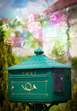 Colorful icons and symbols bursting out of a mailbox Stock Photos