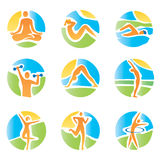 Colorful icons yoga fitness. Colorful icons with fitness and healthy lifestyle activities on an abstract landscape background. Expressive watercolor imitating Royalty Free Stock Photo