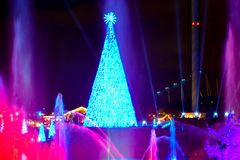 Colorful illuminated Christmas tree and waterjet on dark night background in International Drive area 2. Orlando, Florida. December 25, 2018. Colorful royalty free stock photo