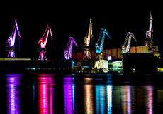 Colorful Illuminated Cranes in Harbor in the Night. Colorful Illuminated Cranes in Harbor of Pula in Croatia in the Night Royalty Free Stock Images