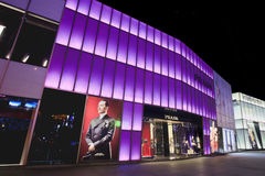 Colorful illuminated Prada outlet in Dalian, China Stock Images