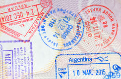 Colorful immigration arrival stamps on passport. Colorful immigration arrival stamps from all over the world on passport Stock Photos