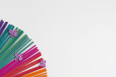 Colorful incense on white background. Royalty Free Stock Photography
