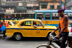 Colorful indian taxi cab stuck in a traffic jam. KOLKATA, INDIA: Colorful indian Ambassador taxi cab stuck in a traffic jam. First Ambassador was produced by the Stock Photo