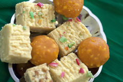 Colorful Indian Diwali sweets in a plain silver dish. Colorful Indian Diwali  sweets in plain silver dish Royalty Free Stock Photo