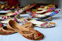 Colorful indian ethnic shoes. On flea market in India. copy space Stock Photography