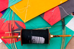 Colorful Indian kites and string. Colorful paper kites and string used in the sport of kite fighting. The special string is covered in glass to make it sharp Royalty Free Stock Photo