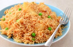 Vegetarian Pulao -Indian vegan glutenfree meal. A colorful Indian rice dish made from basmati rices, spices, and fresh vegetables like potatoes,peas onions Stock Photo