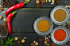 Colorful Indian spices on black wooden table top Stock Photo