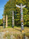 Colorful indian totems in stanley park vancouver canada stock photos