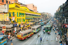 Colorful indin street with many buses, cars and rushing people Stock Image