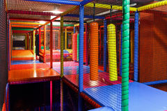 Colorful indoor playground. Colorful 3D Net Maze indoor playground for kids with bumpers, punching cylinder, slide, bridge, balls Royalty Free Stock Photography