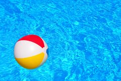 Colorful inflatable ball floating in swimming pool Royalty Free Stock Images