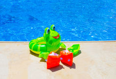 Colorful inflatable ball near swimming pool Royalty Free Stock Photos