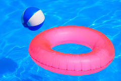 Colorful inflatable ball and round tube Stock Photography
