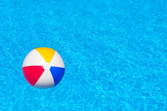 Colorful inflatable ball in swimming pool Stock Photos