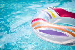 Colorful inflatable floating ring swimming in the pool. Close-up royalty free stock images