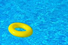 Colorful inflatable tube floating in swimming pool Royalty Free Stock Photos
