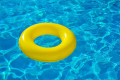 Colorful inflatable tube floating in swimming pool Royalty Free Stock Images
