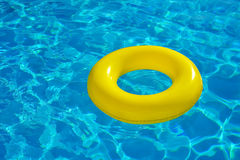 Colorful inflatable tube floating in swimming pool Stock Photos